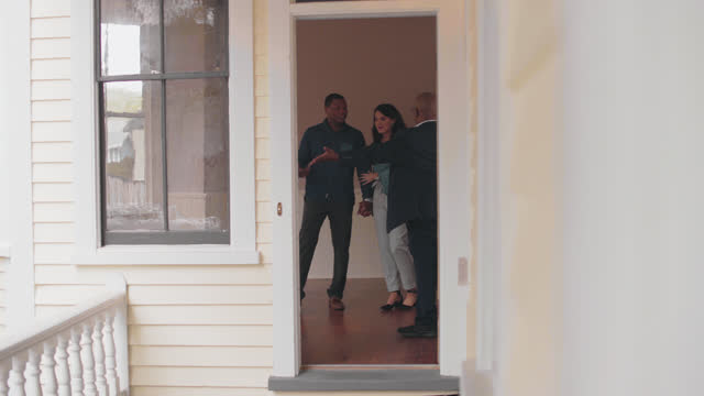 a real estate agent shows an excited couple a house for sale - wilmington north carolina stock videos & royalty-free footage
