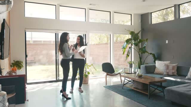 real estate agent shows home to female client - selling stock videos & royalty-free footage