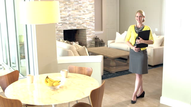 real estate agent standing in home for sale - estate agent stock videos & royalty-free footage