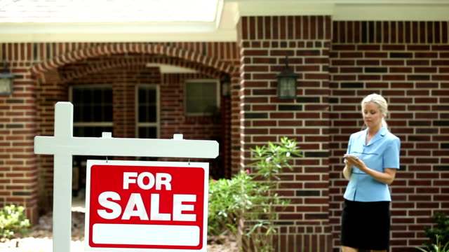 real estate agent using smart phone. home, sign. - front porch stock videos and b-roll footage