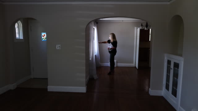 real estate agent wearing a protective mask uses smart phone to provide a virtual video tour of a home for sale in sacramento california us on monday... - home showcase interior stock videos & royalty-free footage