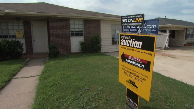 real estate auction sign in front yard of house / louisiana united states - auction stock videos & royalty-free footage