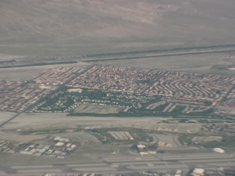 real estate: desert housing development, pull - bringing home the bacon stock videos and b-roll footage
