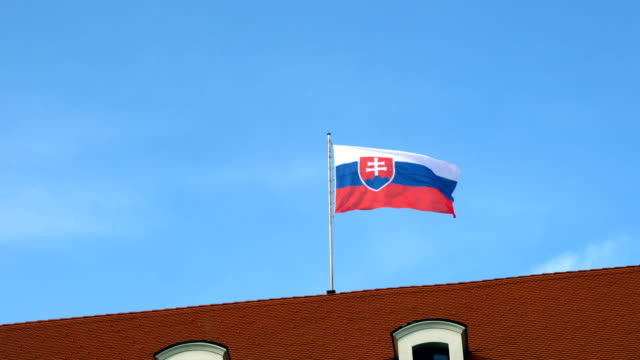 real flag of slovakia with blue sky background - eastern european culture stock videos & royalty-free footage