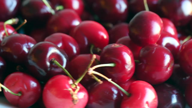 Real imperfect red cherries turning in retail display