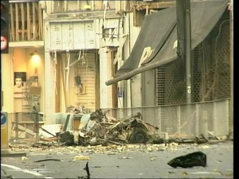 three men convicted lib london ealing flattened wreckage of car following real ira bomb gvs debris on street ltn - ealing stock videos and b-roll footage