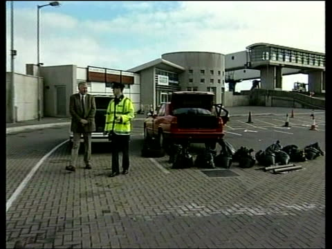 """real ira"" threatens peace process; eire: dun laoghaire: ferry terminal pull out to two bmw cars with boots open and bags of explosive laid around:... - explosive material stock videos & royalty-free footage"