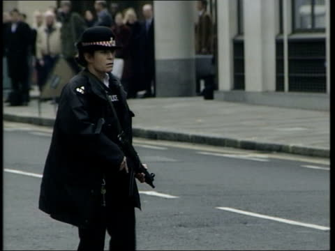 Trial begins ITN ENGLAND London Armed policewoman outside Old Bailey for trial of Real IRA suspects CBV Armed police officer MS Prison van carrying...