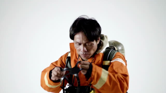 real life : firefighter man in in orange fire-proof uniform - headwear stock videos & royalty-free footage