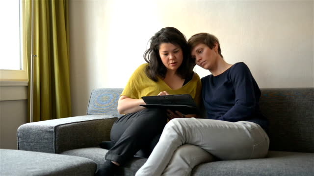 DOLLY: Real life lesbian couple using tablet computer together