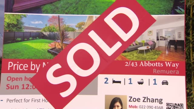 Real Listing real estate sign with large sticker indicating property has been sold