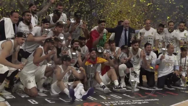 real madrid players celebrate with the trophy after wining the 2018 turkish airlines euroleague championship game against fenerbahce dogus at stark... - basketball player stock videos & royalty-free footage