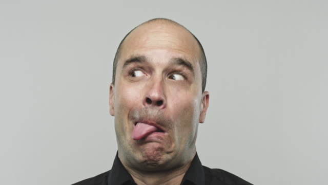 real man making faces. - grimacing stock videos & royalty-free footage