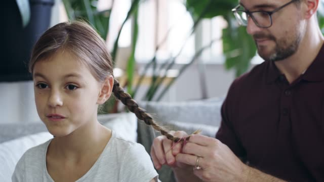 real men braid their daughters' hair - genderblend stock videos & royalty-free footage