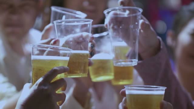 real people cheering and toasting with glasses of beer - drinking beer stock videos and b-roll footage