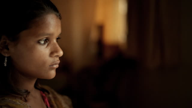 Real people from rural India: Close-up of indoor teenage girl.