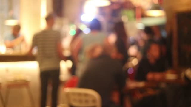 real people having good time in the pub at night. - cafe stock videos & royalty-free footage