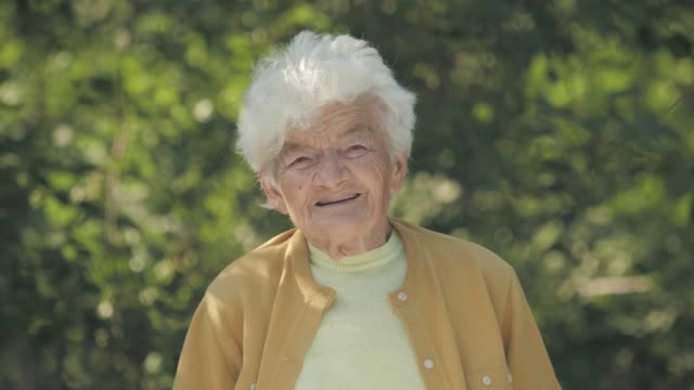 real people senior woman looking at camera and smiling. - 70 79 years stock videos and b-roll footage