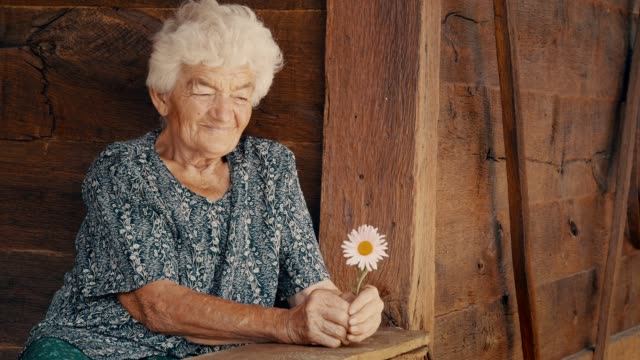 real people senior woman looking at camera and smiling - wrinkled stock videos & royalty-free footage