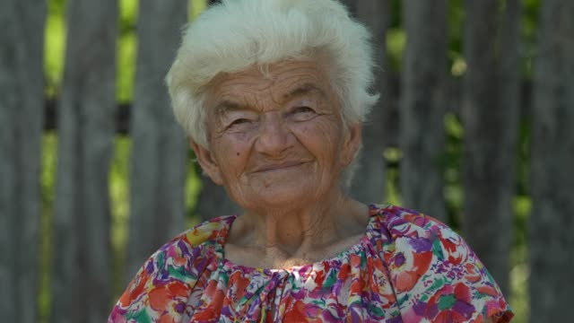 real people senior woman looking at camera and smiling - over 80 stock videos & royalty-free footage