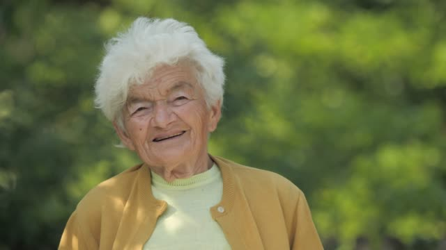 real people senior woman looking at camera and smiling. - senior women stock videos & royalty-free footage