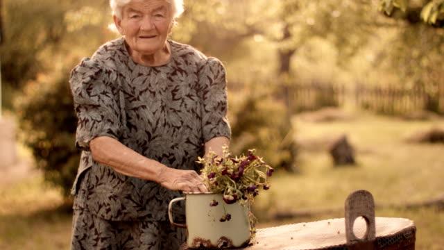 Real People-Senior Woman Planting Flowers, Rural Scene
