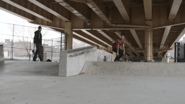 A real person falls skateboarding at a skatepark in Brooklyn, NYC - 4k