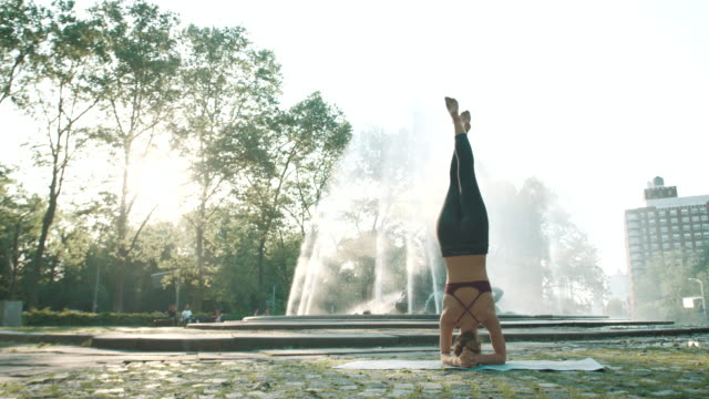 A real person practices Yoga, alone during the summer of 2017 - 4k - slow motion