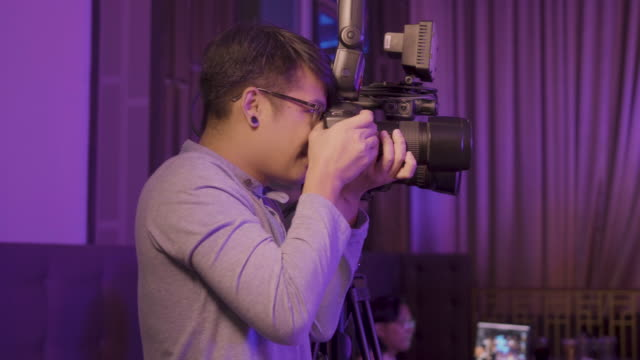 real photographer taking pictures - wedding guest stock videos and b-roll footage