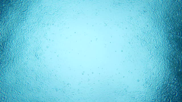 4k real rain drop into water. taken from under swimming pool - concentric stock videos & royalty-free footage