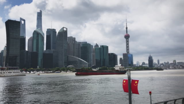 real time 4 k: shanghai skyline at a cloud day. - oriental pearl tower shanghai stock videos & royalty-free footage