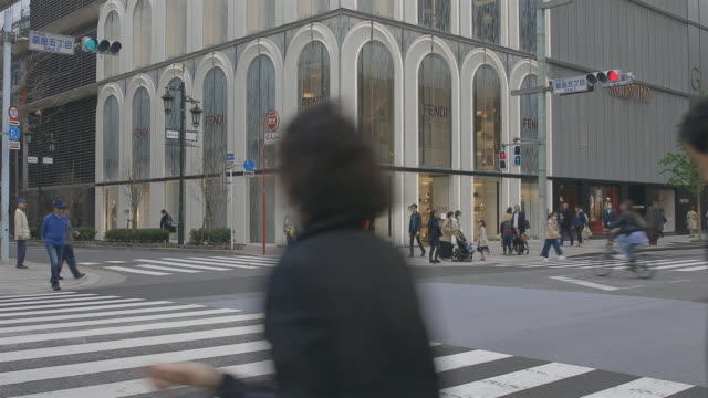 real time 4k: busy streets in pedestrians walking and shopping at ginza district,tokyo,japan. - kanto region stock videos & royalty-free footage