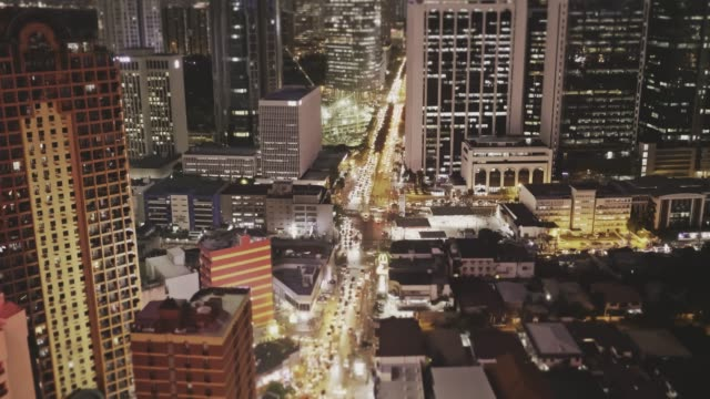 real time aerial video of traffic in makati at night, manila, philippines - manila philippines stock videos and b-roll footage