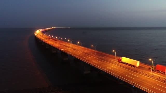 real time aerial view of cars on donghai bridge - truck stock videos & royalty-free footage