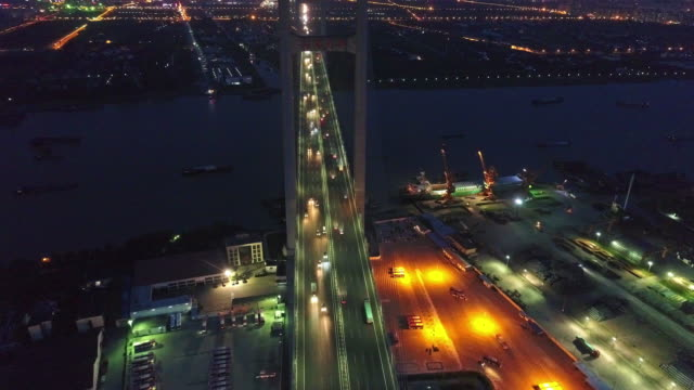 Real Time Aerial view of cars on mingpu bridge over river
