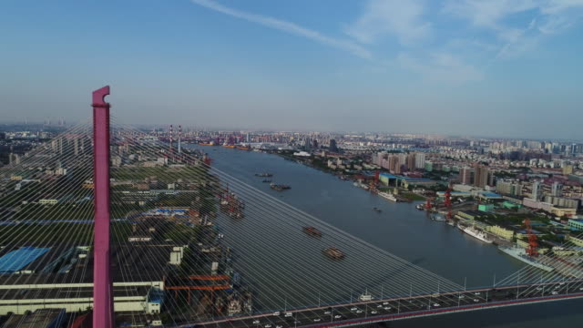 Real Time Aerial view of cars on yangpu bridge over river