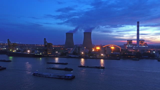 real time aerial view of coal-fired power station at sunset,shanghai,china - coal fired power station stock videos and b-roll footage