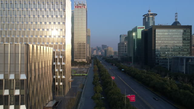 Real time Aerial view of the skyscrapers and urban road in shanghai