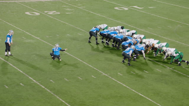 WS Real Time. Aerial view. Skilled kicker kicks field goal and teammates celebrate in professional football game.