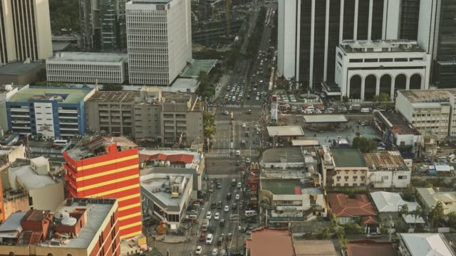 real time aerial view video of traffic in makati, manila, philippines - manila philippines stock videos and b-roll footage