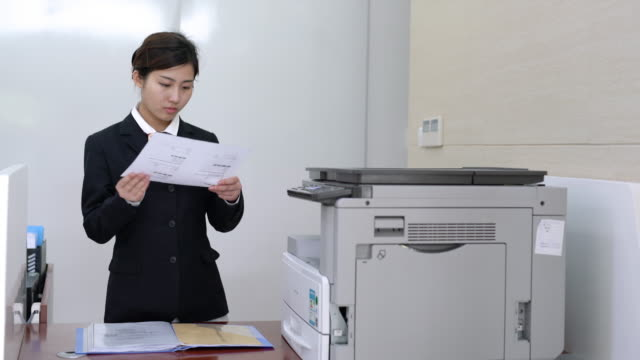 real time bank teller is working on the business - photocopier stock videos and b-roll footage