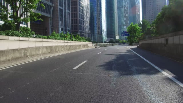 real time car driving in lujiazui financial district, shanghai, china - point of view stock videos & royalty-free footage