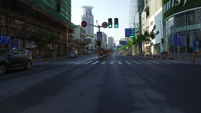 real time car driving on urban road,shanghai,china - car point of view stock videos and b-roll footage