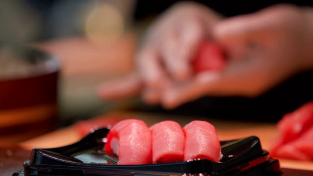 4k real time chef making sushi selective focus. - sushi video stock e b–roll