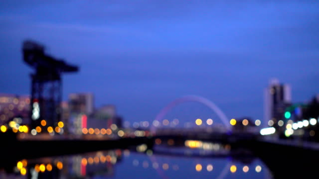 real time defocused of clyde arc bridge at dusk, glasgow, scotland - glasgow scotland stock videos & royalty-free footage