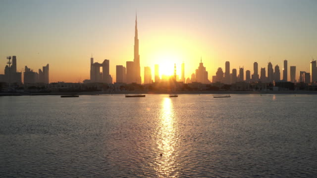 real time dubai skyline at sunrise / dubai, uae - skyline stock videos & royalty-free footage