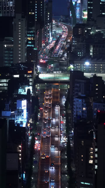 real time night traffic cityscape taken from roppongi hills mori tower, tokyo, japan - roppongi hills stock videos and b-roll footage