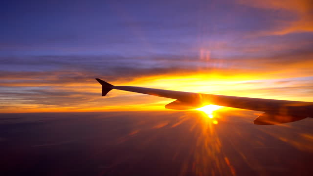 real time of beautiful sunrise through window in the air airplane wing - chiang mai province stock videos & royalty-free footage