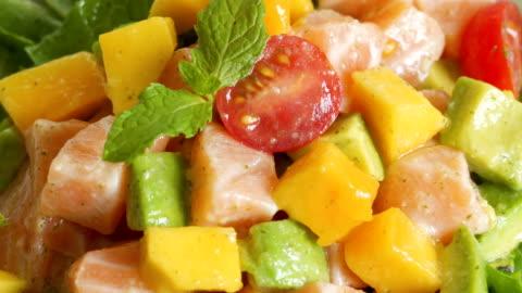 4k real time sauce pours on salad mango salad dish. - mango fruit stock videos & royalty-free footage