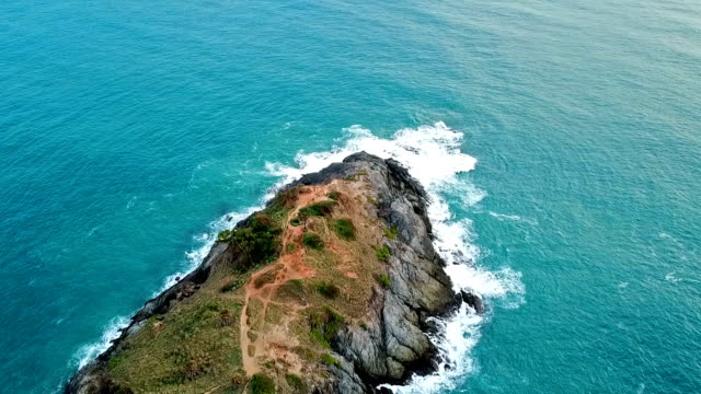 real time shot of sea surf. aerial top down view at cape panwa ,phuket - moving down stock videos and b-roll footage